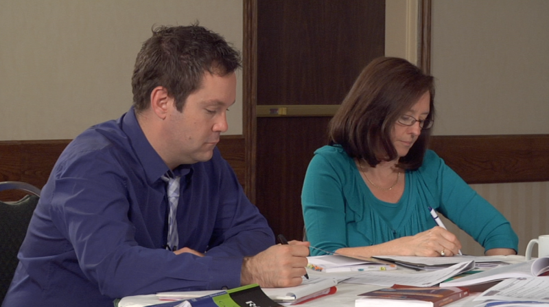 "Still image of teachers marking from ""Moderated Marking Process"" video"