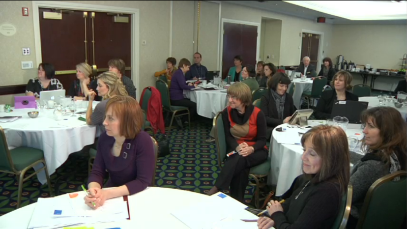 "Image of attendees taken from ""Part Five: Confidence, Competence, and Coherence"" video"